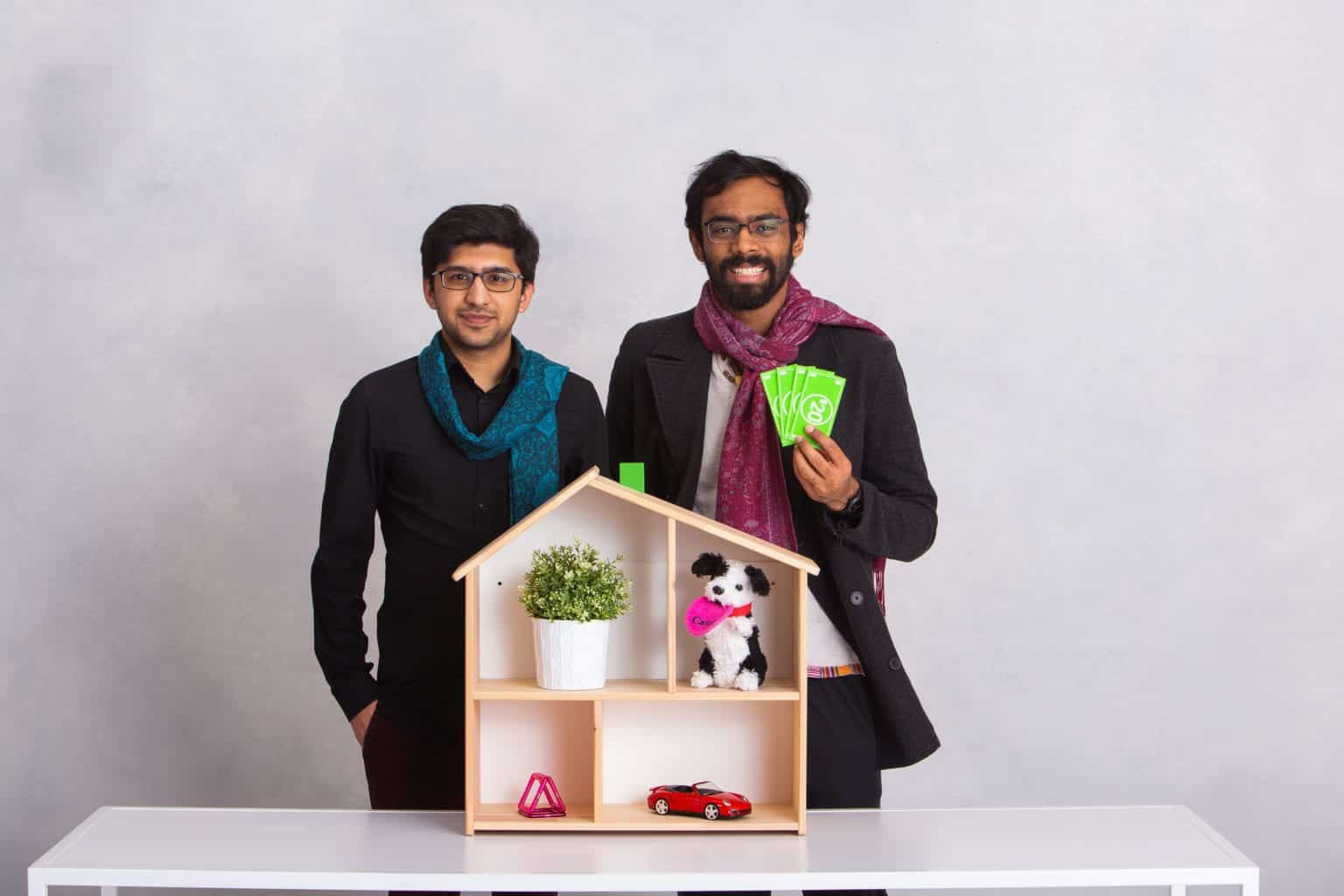 Rashid and Abhiroop standing in front of a model house